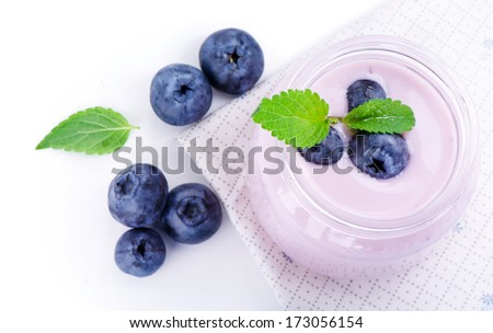 Blueberry berries, leaves of mint and fresh yogurt. - stock photo