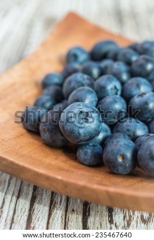 blueberry bowl on wooden background