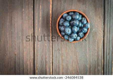 Blueberry bowl on wooden background - vintage effect style pictures