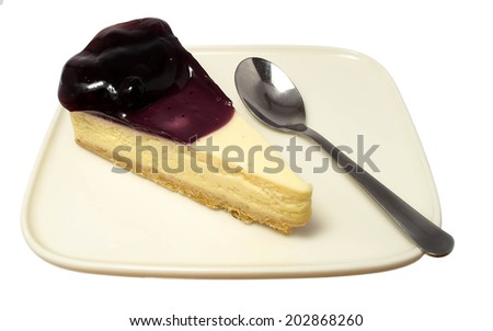blueberry cheese cake on the plate with spoon.