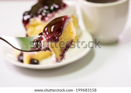Blueberry cheesecake slice and coffee - stock photo