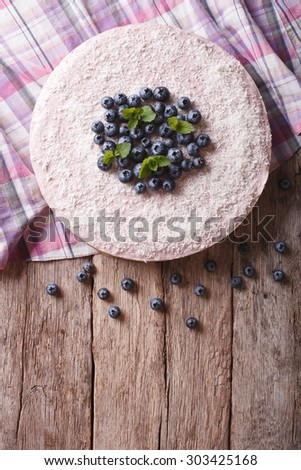 blueberry cheesecake with mint and coconut on the table. vertical top view