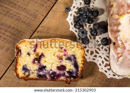 Blueberry coffee cake roll with slice and blueberries