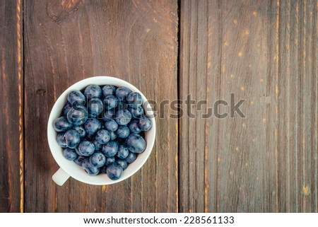 Blueberry cup on wooden background - vintage effect style pictures