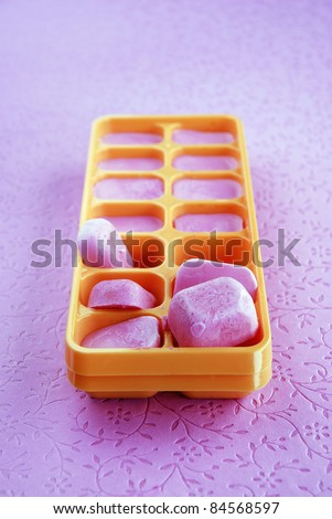 Blueberry-flavored ice cubes - stock photo