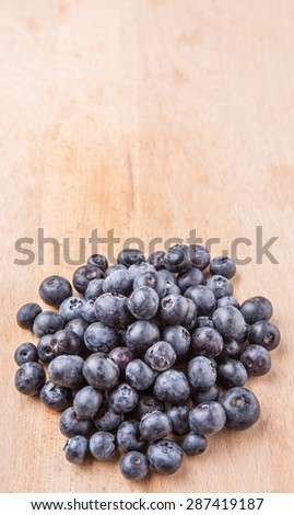 Blueberry fruits on wooden board