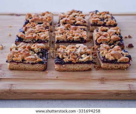 Blueberry hazelnut crumble bars, cake slices, Selective focus - stock ...