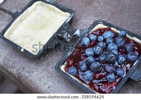 Blueberry Hobo Pie or Camp Pie - stock photo