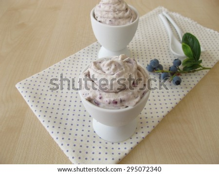 Blueberry ice cream in egg cup - stock photo