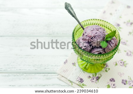 blueberry ice cream on wooden background - stock photo