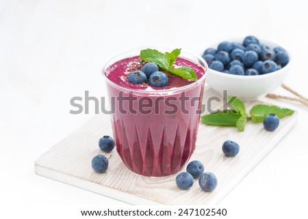 blueberry milkshake with fresh mint and chocolate, close-up - stock photo