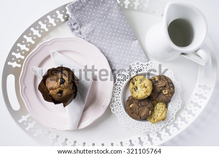 Blueberry muffin, fruit and chocolate cookies