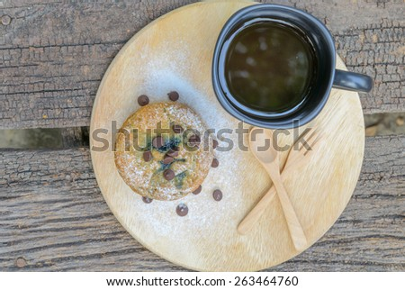 blueberry muffin with coffee cup on wood background - stock photo
