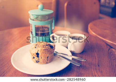 Blueberry muffins with coffee latte made with Vintage Tones,Warm tones - stock photo