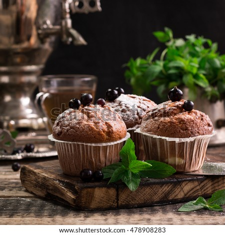 Blueberry muffins with powdered sugar and fresh berries
