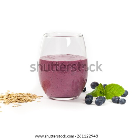 Blueberry Oatmeal Smoothie on white background. Selective focus. - stock photo