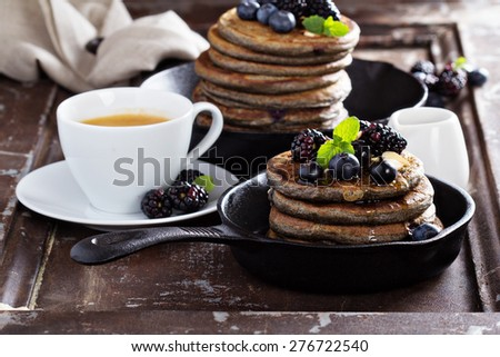 Blueberry pancakes with buckwheat flour for breakfast - stock photo