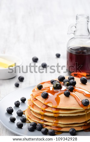 Blueberry pancakes with maple syrup - stock photo