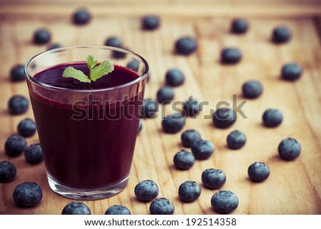 Blueberry smoothie on the table - stock photo