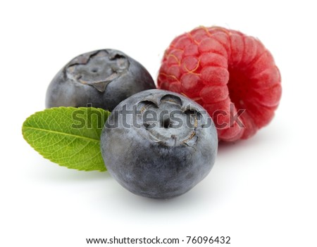Blueberry with raspberry on a white background - stock photo