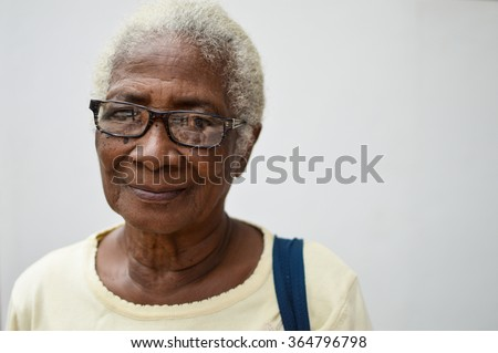 Bluefields, Nicaragua - July 15, 2015:  Beautiful elderly Creole woman poses for the camera on July 15, 2015 in Bluefields, Nicaragua