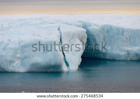 Blueish ice cave in an iceberg. Spitsbergen. - stock photo