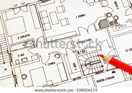 Blueprint and red pencil as symbol for the problems building a house