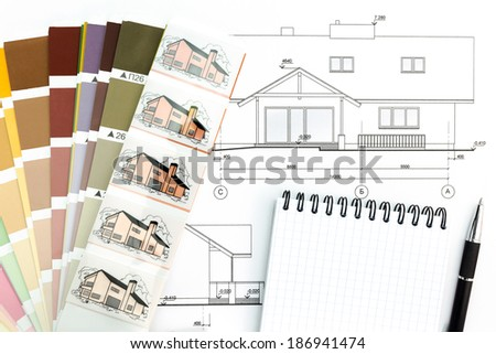 Blueprint of architectural drawing with notepad and color samples - stock photo