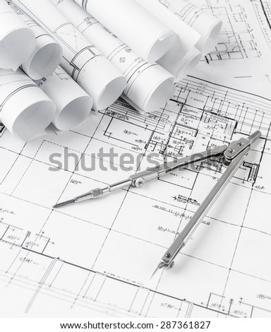 Blueprint plan of house building construction with drawing compass on the worktable