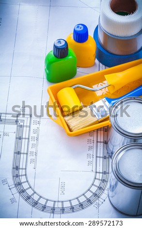 Blueprint with paint brush tray roller cans bottles and adhesive household tapes maintenance concept.