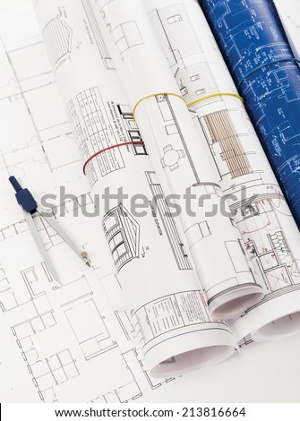 Blueprints and compass - stock photo