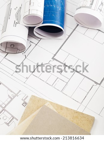 Blueprints and stone samples - stock photo