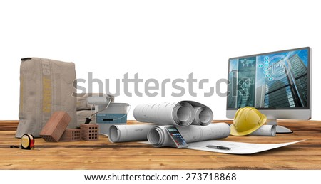blueprints, bricks, pc and cement bag on wood table - stock photo