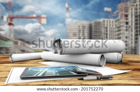 blueprints, tablet, calculator and pen in a construction site - stock photo