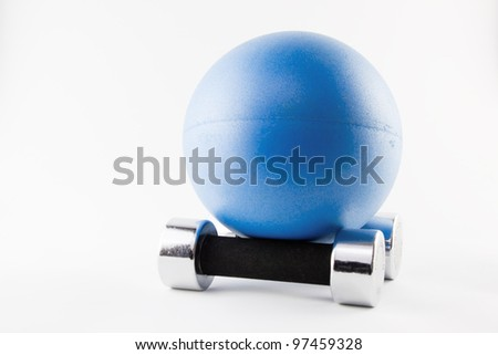 Blues Fitness ball position on two silver hand weights - stock photo