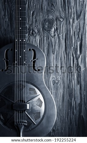 blues guitar on wooden background - stock photo