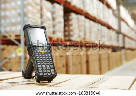 Bluetooth barcode scanner in front of modern warehouse - stock photo