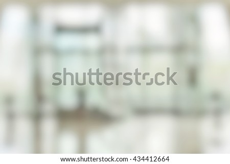 Blur abstract background elevator lift waiting hall with customer or patients in indoor space hospital office hotel bank interior: Blurry perspective view information lobby people walking passing by - stock photo