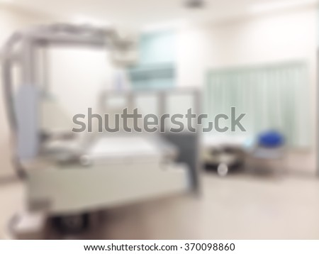Blur abstract background interior of Fluoroscopic Radiology interventional catheter operation room: Blurry indoor space of fluoroscopy x-ray unit machine in clinical imaging department in hospital - stock photo