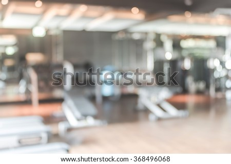 Blur abstract background modern fitness center with health exercise equipment : Blurry perspective view of gym facility service room: Blurred empty gymnasium space for diet, bodybuilding and training - stock photo