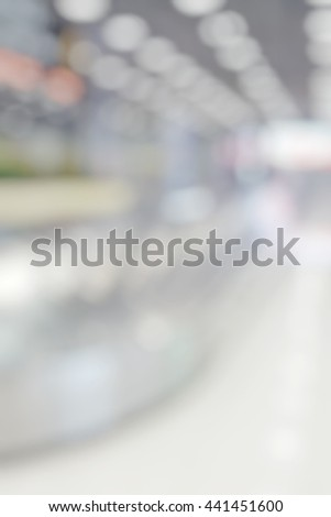 Blur abstract background of  baggage claim at international airport. Blurry view  conveyer belt with no suitcase. - stock photo