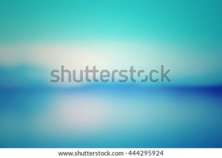 Blur abstract background of countryside landscape. Blurry lights of lamp near riverside balcony. Defocus light sunset view blue green purple vintage tone. - stock photo