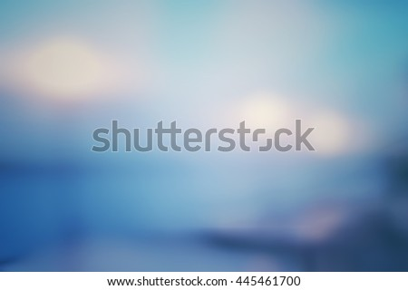 Blur abstract background of countryside landscape. Blurry lights of lamp near riverside balcony. Defocus light sunset view blue green purple vintage tone with bokeh. - stock photo