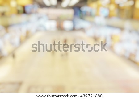 Blur abstract background of kids play ice hockey in ice rink in department stores. Blurry view of athletics practice ice skate in icy floor in indoor mall. - stock photo