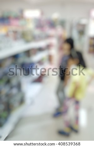 Blur abstract background of kids shopping for toys in toy  store.Blurred image of children find a toy in toy shop.Blurry view of little girls looking for toy - stock photo