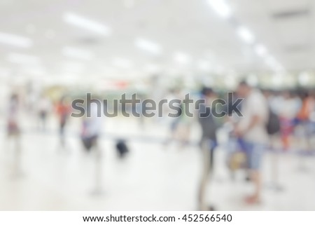 Blur abstract background of travellers at checking point for boarding pass and carry-on baggage at international airport. Blurry view people walking in hall bokeh effect. - stock photo