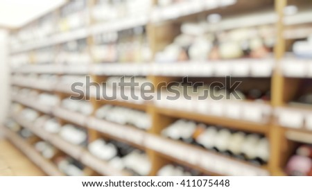 Blur abstract background of wine shop with red and white wines bottles. Blurred of wine bottles.