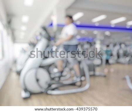 Blur abstract background people lifestyle burning fat on modern fitness center exercise equipment: Blurry perspective view gym facility service room: Gymnasium indoor space diet bodybuilding training - stock photo
