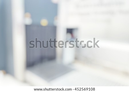 Blur abstract background safety operators scan hand luggage at airport terminal. Blurry view baggage x-ray at checking point of customs. Defocus hold baggage screening room. - stock photo