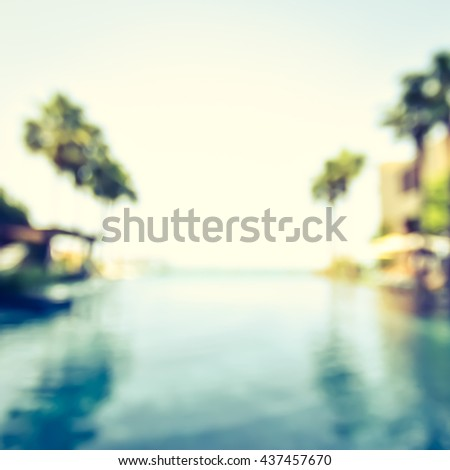Blur abstract background vintage style resort hotel swimming pool reflective water surface, blue cool sky coconut palm tree row: Blurry perspective view vacation summer party holiday relaxation pond - stock photo